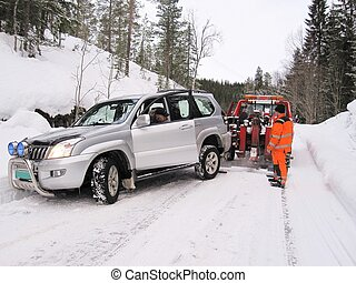 Car rescue helping a driver gettin his car out of the ditch...