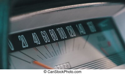 Car Retro Dashboard. Vintage retro speedometer and instrument panel of an old car. Speed 0 to 160 km. Close-up. Retro car interior. Smooth camera movement close-up. Horizontal scale of measurement
