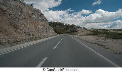 car rides along winding road motorway or highway rush....