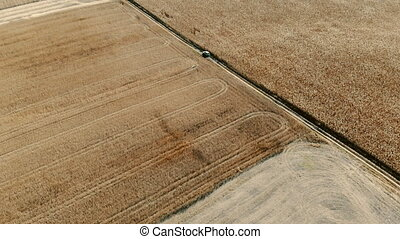 car rides around field, aerial view