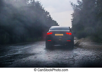 car rides on road in downpour
