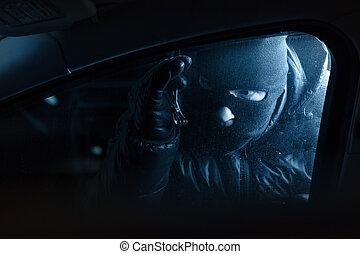 Car robber at night