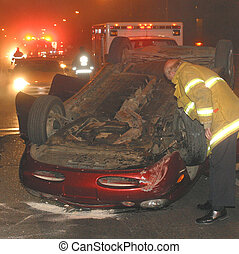 car rollover at night