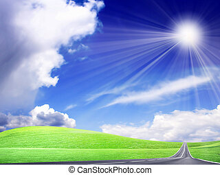 car route amongst green hills on background shining sky