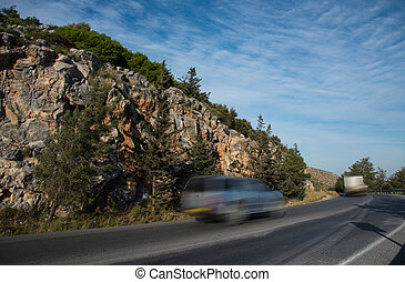 Car running  fast on a curved  dangerous  mountain road