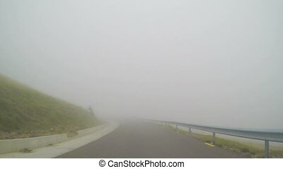 Car running high speed time lapse on bad visibility along...