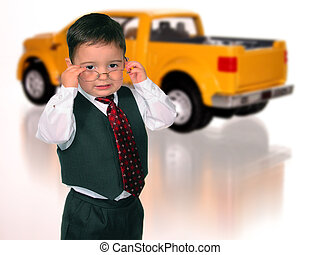 Car Salesman - Little boy in a vest and tie wearing glasses...