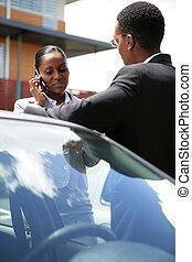 Car salesman with female customer