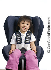 Car Seat 001 - A young girl is straped into a car seat. ...