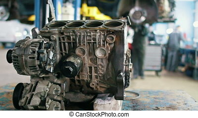 Car service - engine for repairing in vehicle workshop