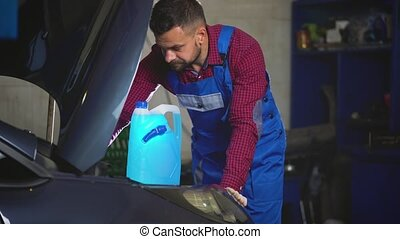Car service, repair, maintenance and people concept - auto...