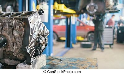 Car service - vehicle engine motor - a mechanic checks the...