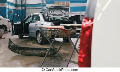 Car service - vehicle for repairing standing in workshop,...