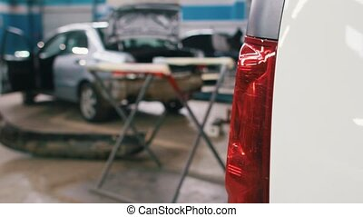 Car service - vehicle for repairing standing in workshop -...