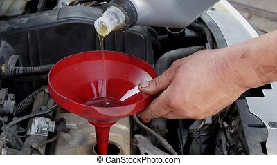Car servicing, mechanic change oil