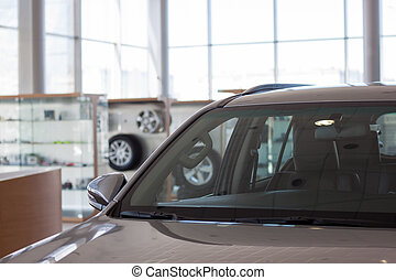 Car showroom. Part of new vehicle in dealership.