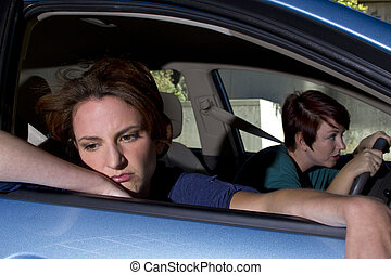 Car Sickness - close up of passenger woman being car sick