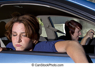 Car Sickness - close up of passenger woman being car sick
