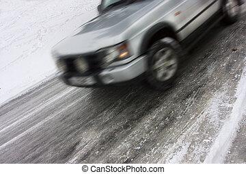 silver 4 wheel drive car skidding on ice
