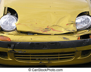 Car smash - Crumpled front on small car after road accident.