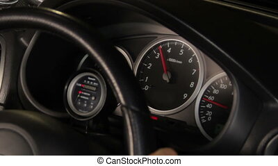a sports car dashboard, showing rpm and high speed acceleration with turbo sound