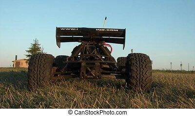 Car Spinning Up Dirt Into Camera - Mini nitro gas car kicks...