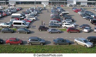 Car stands on grass, has broken ecology on parking near Crocus Expo