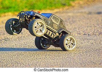 Car - Radio controlled car on two wheels, close image.
