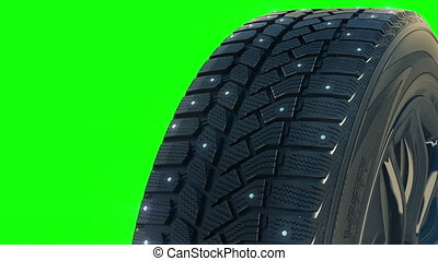 Car studded winter tyre wheel rotate on camera in motion -...