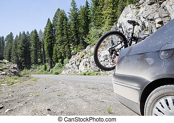 car taking a bike to the trails for some adventure