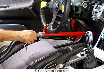 Car theft - Hand locking anti-theft device on car's sterring...