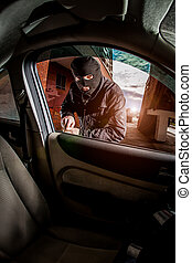 Car thief in a mask. - Robber and the car thief in a mask ...