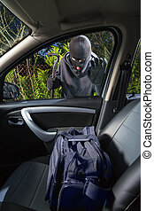 Car thief in a mask - Thief is looking for things left in a...