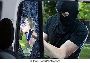 Car thief with crowbar