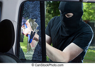 Car thief with crowbar and broken glass