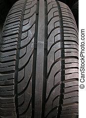 Car Tire - A close-up of a car tire pattern.