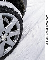 car tire in snow with tread pattern