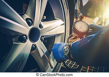 Car Tire Pressure Check in the Auto Service Garage.