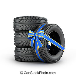 Car tires enveloped ribbon with a bow on a white background.