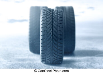 Car tires in winter background