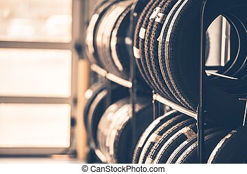 Car Tires Rack. Brand New Tires for Compact Vehicles on the...