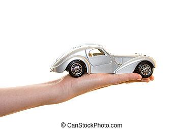 Car toy on palm