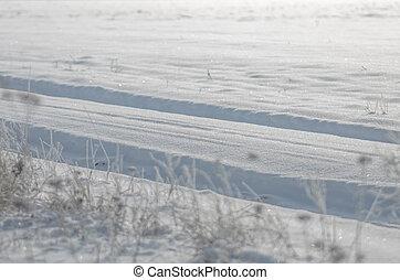 Car tracks in snow
