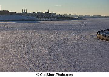 car tracks on the snow