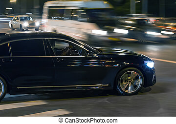 car traffic at night at the intersection of streets in the...