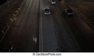 Car traffic at night. High angle shot. Real time.