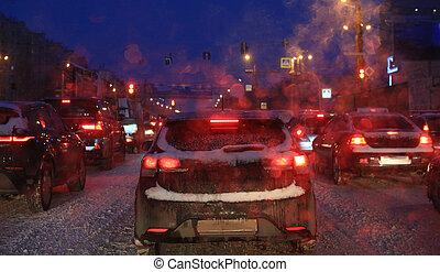 Car traffic at night on winter road