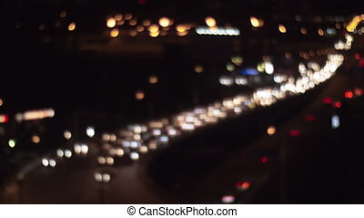 Car traffic in night city, defocus