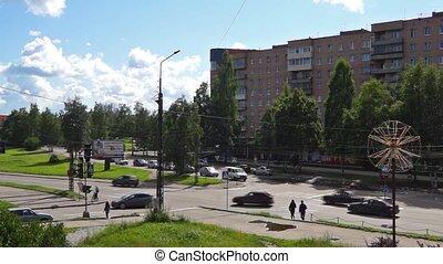 Car traffic in summer city