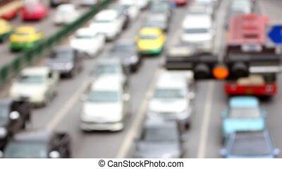 Car traffic, motion blurred.